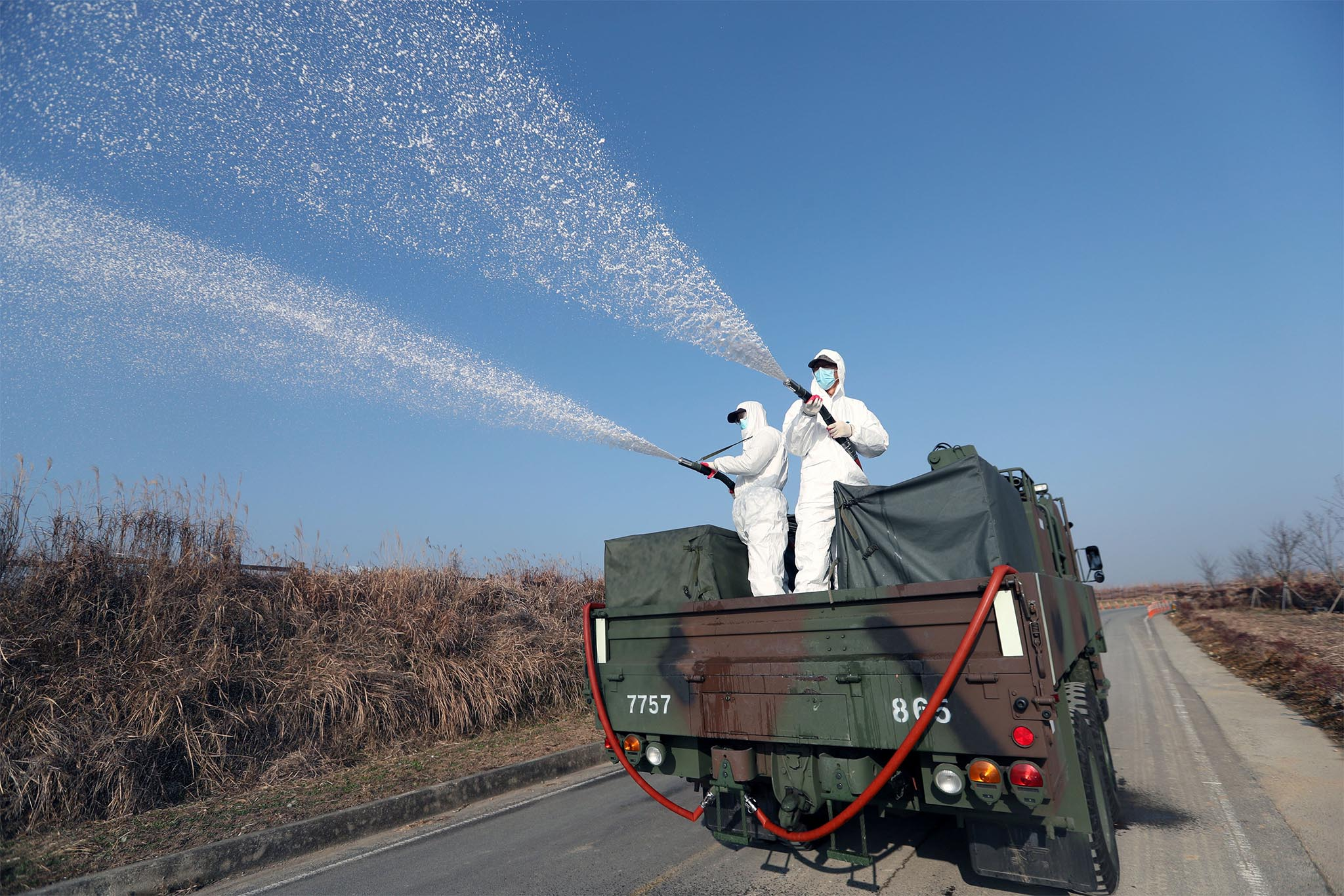South Korean navy soldiers disinfect in Changwon