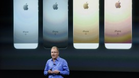 Apple Inc. Announces New iPhone And iPad Pro...Greg Joswiak, vice president of iPod, iPhone, and iOS product marketing for Apple Inc., announces the iPhone SE smartphone during an Apple event in Cupertino, California, U.S., on Monday, March 21, 2016. Apple Inc. Chief Executive Officer Tim Cook is expected to unveil a smaller iPhone Monday in attempt to woo those who are holding on to older versions. Photographer: David Paul Morris/Bloomberg *** Local Caption *** Greg Joswiak