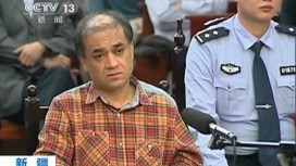 Ilham Tohti during his trial. REUTERS/CCTV via Reuters TV