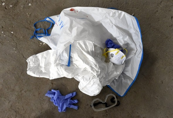 A pile of used protective clothing are seen on the floor at a World Health Organization health training center to deal with Ebola victims in Liberia (PASCAL GUYOT/AFP/Getty Images)