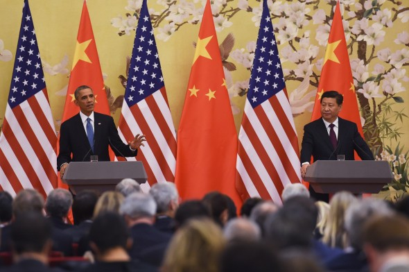 President Barack Obama and President Xi Jinping at a joint press conference in the Great Hall of the People in Beijing on November 12, 2014 (GREG BAKER/AFP/Getty Images)