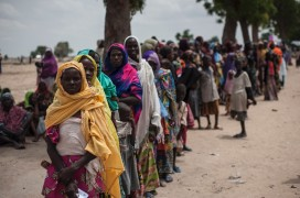 Women and children queue for Unicef nutrition clinic on the outskirts of Maiduguri, Nigeria