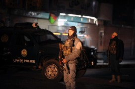 Afghan police guard the governor's compound in Kandahar after the bombing in Jamuary