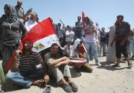 People follow the trial of Hosni Mubarak