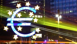 A tram passes the euro sign sculpture in front of the European Central Bank ( ECB) in Frankfurt, Germany. Photographer: Hannelore Foerster/Bloomberg