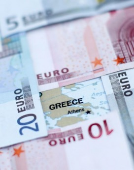 Euro banknotes placed on a map of Greece. Photo: Dado Ruvic, Reuters