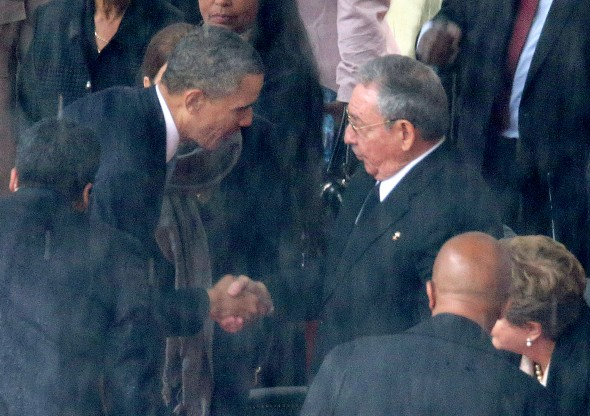 Barack Obama shakes hands with Raul Castro during the official memorial service for Nelson Mandela (Getty)