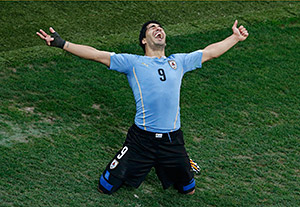 Uruguay's Luis Suarez celebrates scoring his team's second goal against England during their 2014 World Cup Group D soccer match at the Corinthians arena in Sao Paulo June 19, 2014