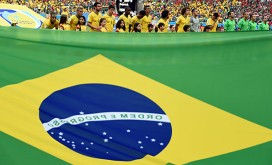 Brazilian players listen to their national anthem before a Group A football match between Bra