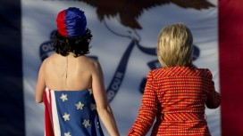 Pop singer Katy Perry and candidate Hillary Rodham Clinton on stage at the Jefferson-Jackson Dinner in Des Moines.