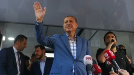 Turkish President Tayyip Erdogan delivers a speech to his supporters in Istanbul