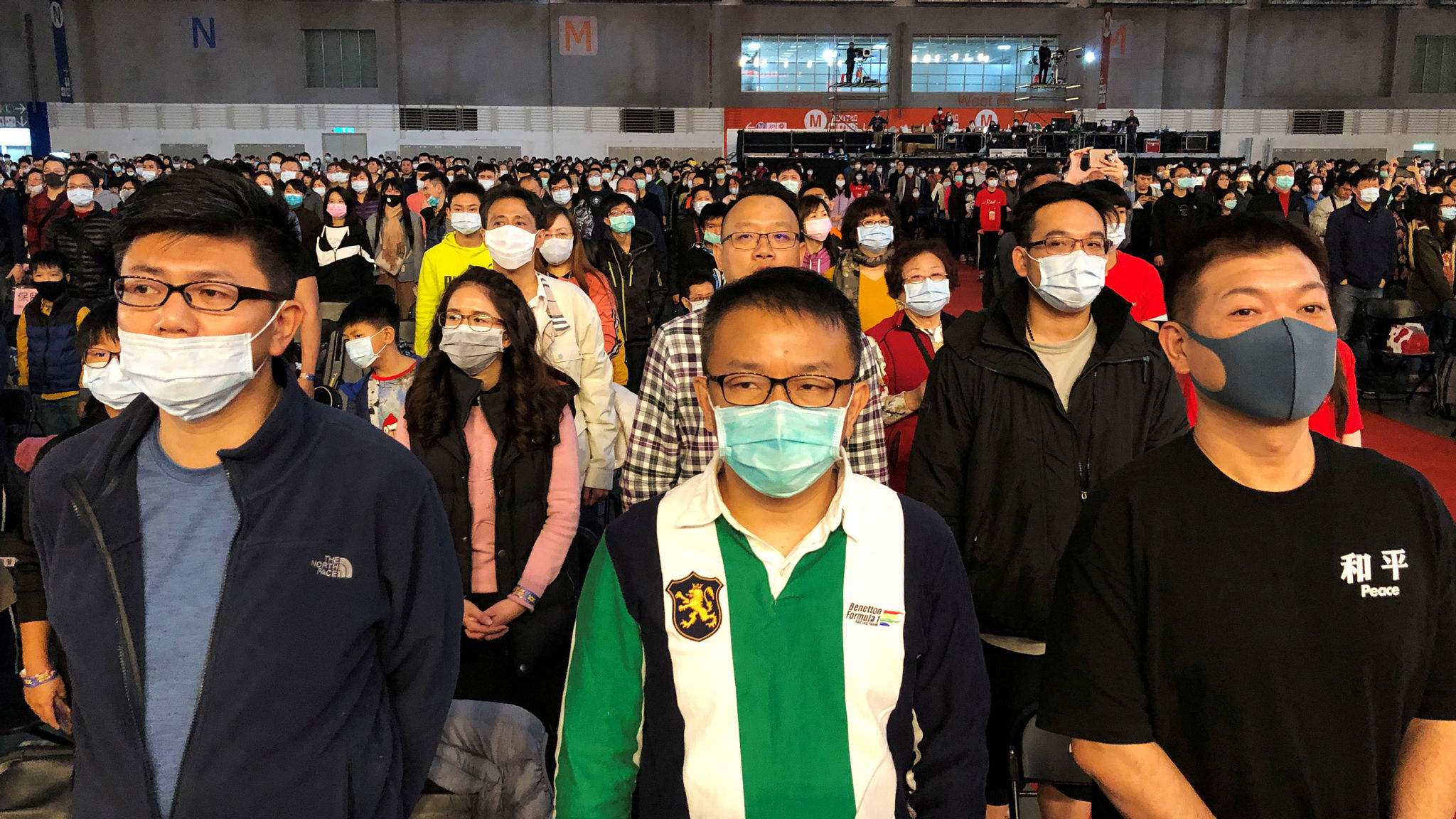 FILE PHOTO: Foxconn employees wearing masks attend the company's year-end gala in Taipei