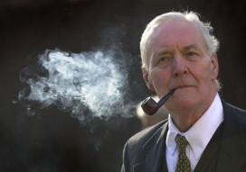 Former MP Tony Benn smokes his pipe outside the Palace of Westminster, London, Tuesday 18 March, 2003, during the debate in the House of Commons on the possibility of war aganist Iraq. See PA story POLITICS Iraq. PA Photo: Matthew Fearn