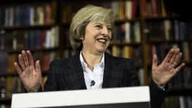 Britain's Home Secretary Theresa May attends a press conference in London
