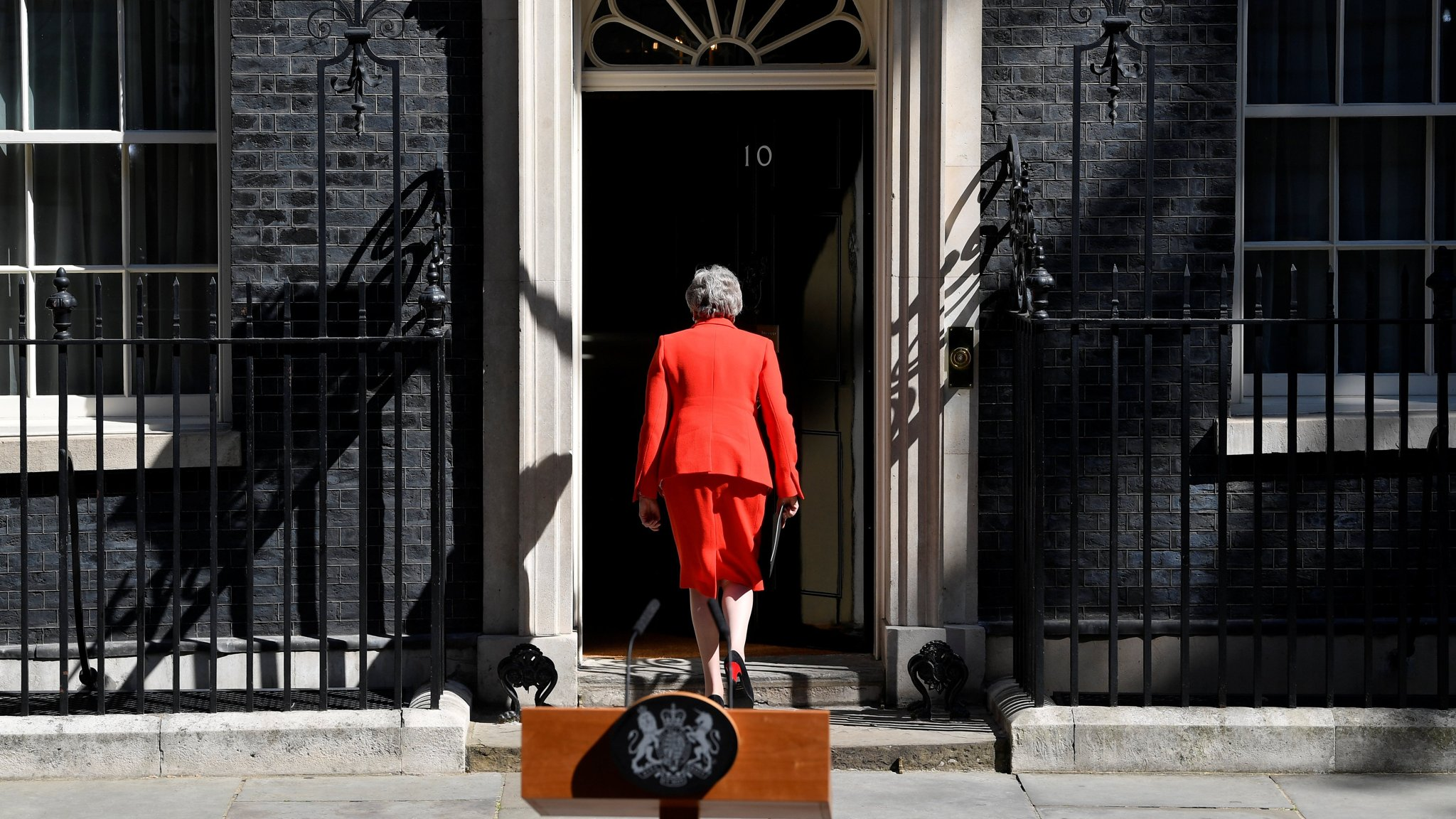 British Prime Minister Theresa May leaves after delivering a statement in London